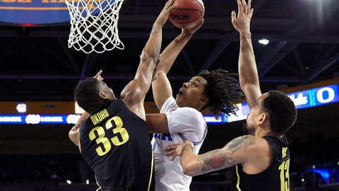 <p>               UCLA center Moses Brown, center, shoots as Oregon forward Francis Okoro, left, and forward Paul White defend during the first half of an NCAA college basketball game Saturday, Feb. 23, 2019, in Los Angeles. (AP Photo/Mark J. Terrill)             </p>