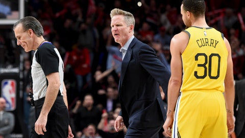 <p>               Golden State Warriors coach Steve Kerr, center, yells at referee Ken Mauer, left, after being called for a technical foul, while guard Stephen Curry, right, watches during the second half of an NBA basketball game against the Portland Trail Blazers in Portland, Ore., Wednesday, Feb. 13, 2019. The Blazers won 129-107. (AP Photo/Steve Dykes)             </p>