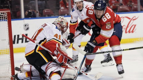 <p>               Florida Panthers left wing Mike Hoffman tries to score against as Calgary Flames goaltender Mike Smith blocks the puck during the first period of an NHL hockey game Thursday, Feb. 14, 2019, in Sunrise, Fla. (AP Photo/Brynn Anderson)             </p>