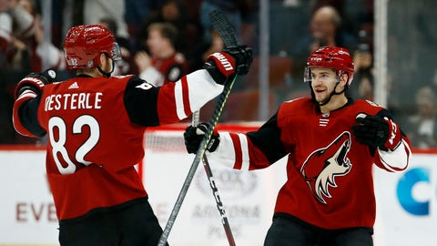 <p>               Arizona Coyotes center Vinnie Hinostroza, right, celebrates his goal against the Florida Panthers with Coyotes defenseman Jordan Oesterle (82) during the shootout in an NHL hockey game Tuesday, Feb. 26, 2019, in Glendale, Ariz. The Coyotes won 4-3. (AP Photo/Ross D. Franklin)             </p>
