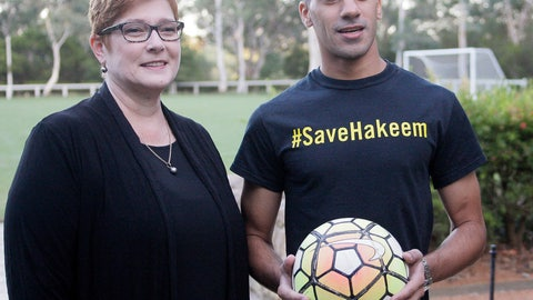 <p>               Australian Foreign Minister Marise Payne, left, and refugee soccer player Hakeem al-Araibi pose for a photograph before a soccer match at Parliament House in Canberra, Australia, Thursday, Feb.14, 2019. Al-Araibi was detained in Thailand for three months under threat of extradition to Bahrain and has come to Canberra to shake hands with the prime minister and say thank you for his freedom. (AP Photo/Rod McGuirk)             </p>