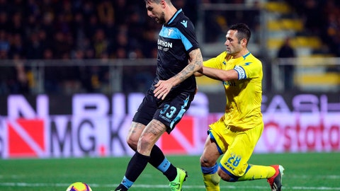 <p>               Lazio's Francesco Acerbi, left, vies for the ball with Frosinone's Camillo Ciano during the Serie A soccer match between Frosinone and Lazio at the Benito Stirpe stadium in Frosinone, Italy, Monday, Feb. 4, 2019. (Federico Proietti/ANSA via AP)             </p>