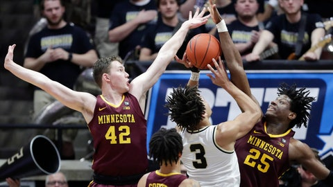 <p>               Purdue guard Carsen Edwards (3) ties to shoot between Minnesota forward Michael Hurt (42) and center Daniel Oturu (25) during the first half of an NCAA college basketball game in West Lafayette, Ind., Sunday, Feb. 3, 2019. (AP Photo/Michael Conroy)             </p>