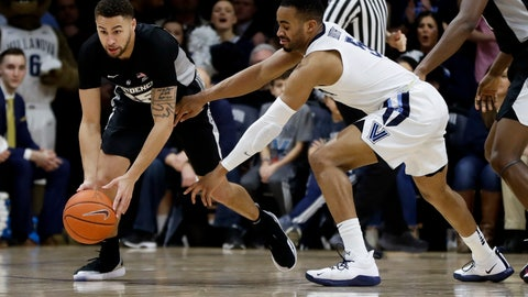 <p>               Providence's Drew Edwards, left, and Villanova's Phil Booth chase a loose ball during the first half of an NCAA college basketball game, Wednesday, Feb. 13, 2019, in Villanova, Pa. (AP Photo/Matt Slocum)             </p>