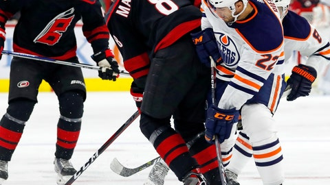 <p>               Carolina Hurricanes' Saku Maenalanen (8) and Edmonton Oilers' Tobias Rieder (22) compete for the puck during the first period of an NHL hockey game Friday, Feb. 15, 2019, in Raleigh, N.C. (AP Photo/Karl B DeBlaker)             </p>