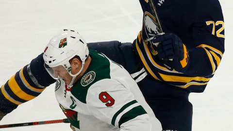 <p>               Buffalo Sabres forward Tage Thompson (72) and Minnesota Wild forward Mikko Koivu (9) collide during the first period of an NHL hockey game, Tuesday, Feb. 5, 2019, in Buffalo N.Y. (AP Photo/Jeffrey T. Barnes)             </p>
