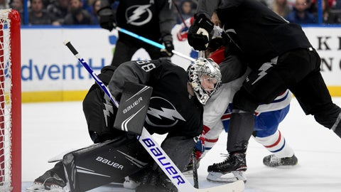 <p>               Tampa Bay Lightning goaltender Andrei Vasilevskiy (88) covers the puck during the first period of an NHL hockey game against the Montreal Canadiens, Saturday, Feb. 16, 2019, in Tampa, Fla. (AP Photo/Jason Behnken)             </p>