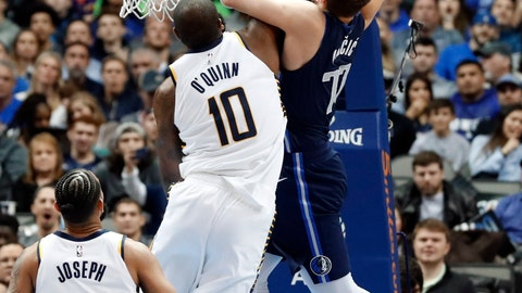 <p>               Dallas Mavericks forward Luka Doncic, right, is fouled going to the basket for a shot by Indiana Pacers center Kyle O'Quinn, left, as Cory Joseph (6) watches in the first half of an NBA basketball game in Dallas, Wednesday, Feb. 27, 2019. O'Quinn was issued a flagrant foul on the play. (AP Photo/Tony Gutierrez)             </p>