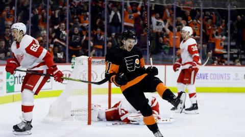 <p>               Philadelphia Flyers' Travis Konecny (11) celebrates after scoring the game-winning goal during overtime of an NHL hockey game against the Detroit Red Wings, Saturday, Feb. 16, 2019, in Philadelphia. The Flyers won 6-5. (AP Photo/Matt Slocum)             </p>