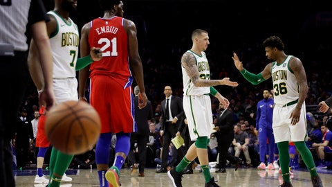 <p>               Boston Celtics' Marcus Smart (36) and Daniel Theis (27) celebrate after the Philadelphia 76ers called a timeout during the second half of an NBA basketball game, Tuesday, Feb. 12, 2019, in Philadelphia. Boston won 112-109. (AP Photo/Matt Slocum)             </p>