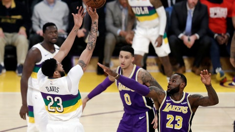 <p>               New Orleans Pelicans' Anthony Davis, left, shoots over Los Angeles Lakers' LeBron James (23) during the first half of an NBA basketball game Wednesday, Feb. 27, 2019, in Los Angeles. (AP Photo/Marcio Jose Sanchez)             </p>