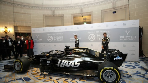 <p>               Drivers Romain Grosjean, right, and Kevin Magnussen pose during the unveiling of their new Rich Energy Haas F1 Team 2019 car, launched at the Royal Automobile Club in London, Thursday Feb. 7, 2019. (Steven Paston/PA via AP)             </p>