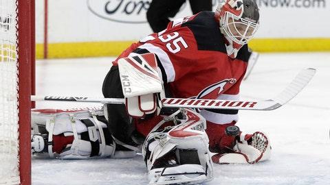 <p>               New Jersey Devils goaltender Cory Schneider blocks a shot form New York Islanders center Mathew Barzal during the first period of an NHL hockey game Thursday, Feb. 7, 2019, in Newark, N.J. (AP Photo/Julio Cortez)             </p>