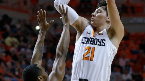 <p>               Oklahoma State guard Lindy Waters III (21) shoots over Kansas State guard Barry Brown Jr. (5) during the first half of an NCAA college basketball game in Stillwater, Okla., Saturday, Feb. 2, 2019. (AP Photo/Sue Ogrocki)             </p>