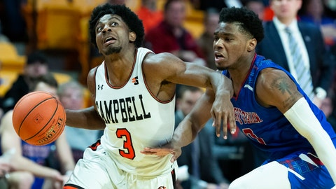 <p>               Campbell University guard Chris Clemons (3), heads to the basket while being covered by Presbyterian College guard Chris Martin in the first half of an NCAA basketball game Thursday, Jan. 24, 2019 in Buies Creek, N.C. Clemons keeps hitting shots near mid court logos, dunking in traffic and passing big names on the list of college basketball's best all-time scorers. The national scoring leader at 29.1 points, has a fearless game packed into a 5-foot-9 frame, making the senior the headliner of college basketball's crop of big-time undersized scorers,  including No. 10 Marquette's Markus Howard and No. 12 Purdue's Carsen Edwards. (AP Photo/Jason E. Miczek)             </p>