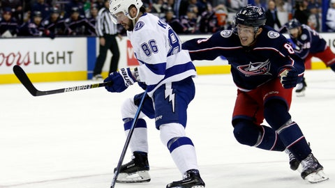 <p>               Tampa Bay Lightning forward Nikita Kucherov, left, of Russia, chases the puck against Columbus Blue Jackets defenseman Zach Werenski during the first period of an NHL hockey game in Columbus, Ohio, Monday, Feb. 18, 2019. Kucherov scored on the play. (AP Photo/Paul Vernon)             </p>