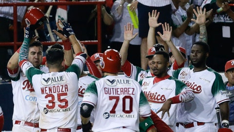 <p>               Victor Mendoza of Mexico's Los Charros de Jaliscos, celebrate with teammates his 2-run home run against Venezuela's Cardenales de Lara during the sixth inning of a Caribbean Series baseball tournament game at the Rod Carew stadium in Panama City, Friday, Feb. 8, 2019. (AP Photo/Arnulfo Franco)             </p>