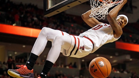 <p>               Texas Tech's Tariq Owens hangs from the rim after dunking during the first half of the team's NCAA college basketball game against Oklahoma State, Wednesday, Feb. 27, 2019, in Lubbock, Texas. (AP Photo/Brad Tollefson)             </p>