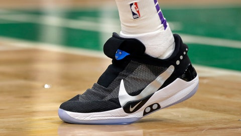 <p>               In this Feb. 7, 2019, photo, Los Angeles Lakers forward Kyle Kuzma walks on the court during an NBA basketball game against the Boston Celtics in Boston. He is wearing Nike's latest performance basketball shoes, which from concept to reality, took about three years to put together. Or 30 years, depending on how you count. The Nike Adapt BB _ a self-lacing smart shoe that can be controlled by a smartphone _ gets released to the public on Sunday, Feb. 17, 2019, a date that just happens to coincide with the NBA All-Star Game in Charlotte. It has a motor embedded within the shoe, and a hefty $350 price tag. It has a motor embedded within the shoe, and a hefty $350 price tag. (AP Photo/Elise Amendola)             </p>