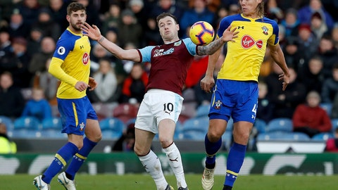 <p>               Burnley's Ashley Barnes, center, in action with Southampton's Jannik Vestergaard during the English Premier League soccer match at Turf Moor, Burnley, England, Saturday Feb. 2, 2019. (Martin Rickett/PA via AP)             </p>