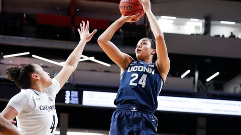 <p>               Connecticut's Napheesa Collier (24) shoots over Cincinnati's Angel Rizor (4) in the first half of an NCAA college basketball game, Saturday, Feb. 2, 2019, in Cincinnati. (AP Photo/John Minchillo)             </p>
