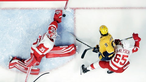 <p>               Detroit Red Wings goaltender Jimmy Howard (35) makes a stop on a shot by Nashville Predators left wing Filip Forsberg (9), of Sweden, during the first period of an NHL hockey game Tuesday, Feb. 12, 2019, in Nashville, Tenn. Also defending for Detroit is Danny DeKeyser (65). (AP Photo/Mark Humphrey)             </p>