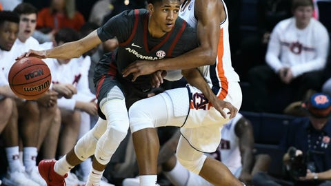<p>               Auburn forward Chuma Okeke, right,  pressures Arkansas guard Isaiah Joe, left, during the first half of an NCAA college basketball game Wednesday, Feb. 20, 2019, in Auburn, Ala. (AP Photo/Julie Bennett)             </p>