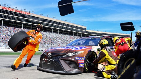 <p>               Crew members tend to Kyle Busch's car during a pit stop in a NASCAR Monster Energy NASCAR Cup Series auto race at Atlanta Motor Speedway, Sunday, Feb. 24, 2019, in Hampton, Ga. (AP Photo/Scott Cunningham)             </p>