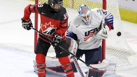 <p>               U.S. goaltender Alex Rigsby (33) makes a save next to Canada forward Ann-Sophie Bettez (39) during the second period of a Rivalry Series hockey game in London, Ontario, Tuesday, Feb. 12, 2019. (Nicole Osborne/The Canadian Press via AP)             </p>