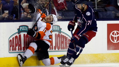 <p>               Philadelphia Flyers forward Travis Konecny collides with the boards in front of Columbus Blue Jackets forward Nick Foligno during the first period of an NHL hockey game in Columbus, Ohio, Thursday, Feb. 28, 2019. (AP Photo/Paul Vernon)             </p>