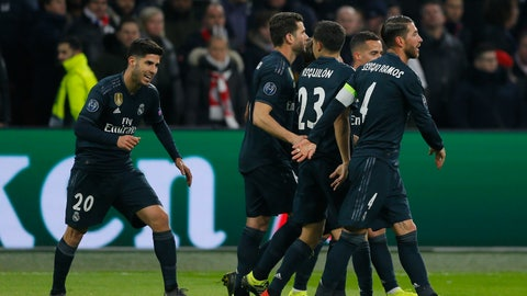 <p>               Real midfielder Marco Asensio, left, celebrates after scoring his side's second goal during the first leg, round of sixteen, Champions League soccer match between Ajax and Real Madrid at the Johan Cruyff ArenA in Amsterdam, Netherlands, Wednesday Feb. 13, 2019. (AP Photo/Peter Dejong)             </p>