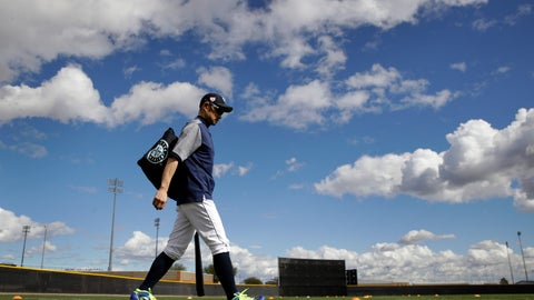<p>               Seattle Mariners' Ichiro Suzuki walks onto a practice field during baseball spring training Saturday, Feb. 16, 2019, in Peoria, Ariz. (AP Photo/Charlie Riedel)             </p>