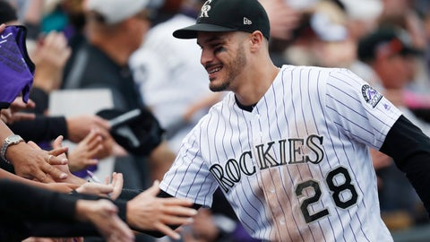 <p>               FILE - In this Sept. 30, 2018, file photo, fans congratulate Colorado Rockies third baseman Nolan Arenado after the Rockies defeated the Washington 12-0, in Denver. The sluggish free agent market the last two years has not scared off Colorado third baseman Nolan Arenado, who could be among the prizes in the 2020 pool. (AP Photo/David Zalubowski, File)             </p>
