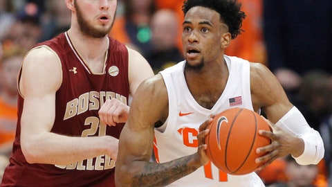 <p>               Syracuse's Oshae Brissett, right, looks to pass the ball while being guarded by Boston College's Nik Popovic, left, during the second half of an NCAA college basketball game in Syracuse, N.Y., Saturday, Feb. 9, 2019. Syracuse won 67-56. (AP Photo/Nick Lisi)             </p>