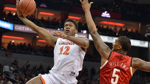 <p>               Virginia guard De'Andre Hunter (12) attempts a shot over the reach of Louisville center Malik Williams (5) during the first half of an NCAA college basketball game in Louisville, Ky., Saturday, Feb. 23, 2019. (AP Photo/Timothy D. Easley)             </p>