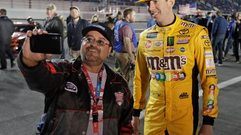 <p>               Kyle Busch, right, poses for a selfie photo with a race fan before the first of two qualifying auto races for the NASCAR Daytona 500 at Daytona International Speedway, Thursday, Feb. 14, 2019, in Daytona Beach, Fla. (AP Photo/John Raoux)             </p>
