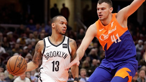 <p>               Brooklyn Nets' Shabazz Napier (13) drives past Cleveland Cavaliers' Ante Zizic (41), from Croatia, in the first half of an NBA basketball game, Wednesday, Feb. 13, 2019, in Cleveland. (AP Photo/Tony Dejak)             </p>