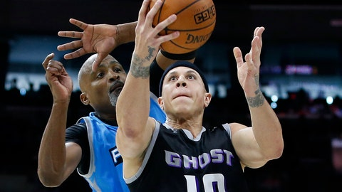 <p>               FILE - This is a July 16, 2017, file photo showing Ghost Ballers' Mike Bibby (10) attempting a shot as Power's Cuttino Mobley defends during the first half of a BIG3 Basketball League game in Philadelphia. Officials in a suburban Phoenix school district say police are investigating sexual abuse and harassment accusations lodged against former NBA player Mike Bibby, who coaches a school basketball team. (AP Photo/Rich Schultz, File)             </p>