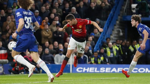 <p>               Manchester United's Ander Herrera, center, scores the opening goal of the game during the English FA Cup fifth round soccer match between Chelsea and Manchester United at Stamford Bridge stadium in London, Monday, Feb. 18, 2019. (AP Photo/Alastair Grant)             </p>