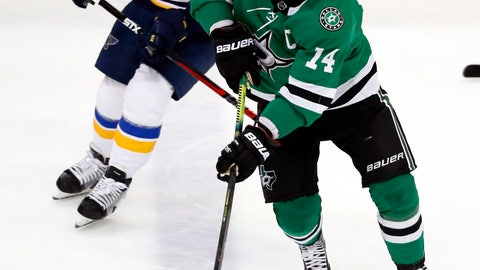 <p>               Dallas Stars left wing Jamie Benn (14) controls the puck in front of St. Louis Blues left wing Ivan Barbashev (49) during the first period of an NHL hockey game in Dallas, Thursday, Feb. 21, 2019. (AP Photo/Tony Gutierrez)             </p>