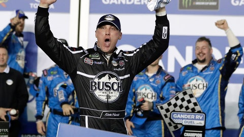 <p>               Kevin Harvick celebrates in Victory Lane after winning the first of two qualifying auto races for the NASCAR Daytona 500 at Daytona International Speedway, Thursday, Feb. 14, 2019, in Daytona Beach, Fla. (AP Photo/John Raoux)             </p>