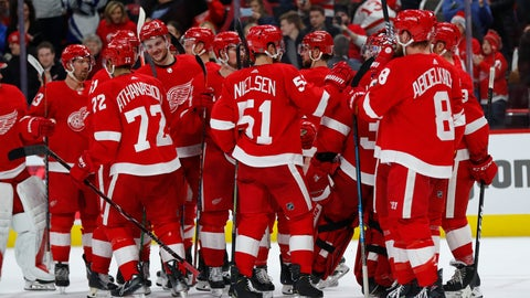 <p>               Detroit Red Wings players celebrate their 3-2 win over the Ottawa Senators after an NHL hockey game Thursday, Feb. 14, 2019, in Detroit. (AP Photo/Paul Sancya)             </p>