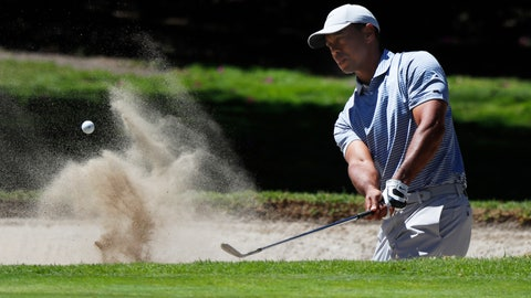 <p>               Tiger Woods hits from a sand trap on the first day of competition of the WGC-Mexico Championship at the Chapultepec Golf Club in Mexico City, Thursday, Feb. 21, 2019. (AP Photo/Marco Ugarte)             </p>