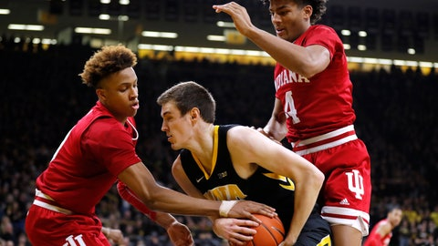 <p>               Iowa forward Nicholas Baer, center, grabs a rebound between Indiana's Romeo Langford, left, and Jake Forrester during the first half of an NCAA college basketball game Friday, Feb. 22, 2019, in Iowa City, Iowa. (AP Photo/Charlie Neibergall)             </p>