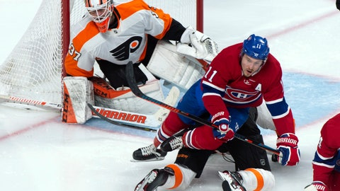 <p>               Montreal Canadiens' Brendan Gallagher falls over Philadelphia Flyers defenceman Robert Hagg in front of goaltender Brian Elliott during the third period of an NHL hockey game Thursday, Feb. 21, 2019, in Montreal. (Paul Chiasson/The Canadian Press via AP)             </p>