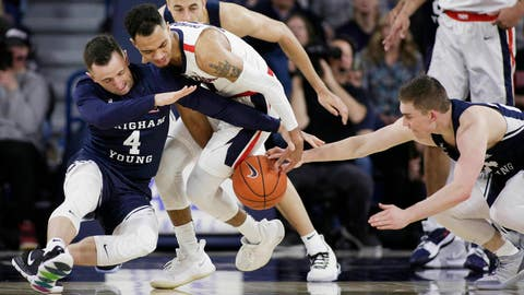 <p>               BYU guard Nick Emery (4) and guard McKay Cannon, right, and Gonzaga guard Geno Crandall go after the ball during the first half of an NCAA college basketball game in Spokane, Wash., Saturday, Feb. 23, 2019. (AP Photo/Young Kwak)             </p>
