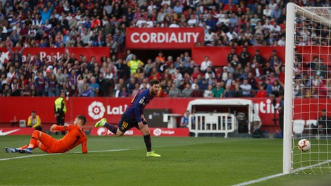 <p>               Barcelona forward Lionel Messi scores his side's third goal during La Liga soccer match between Sevilla and Barcelona at the Ramon Sanchez Pizjuan stadium in Seville, Spain. Saturday, February 23, 2019. (AP Photo/Miguel Morenatti)             </p>