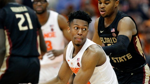 <p>               Syracuse's Tyus Battle, right, looks to pass the ball while being guarded by Florida State's M.J. Walker, right, during the first half of an NCAA college basketball game in Syracuse, N.Y., Tuesday, Feb. 5, 2019. (AP Photo/Nick Lisi)             </p>
