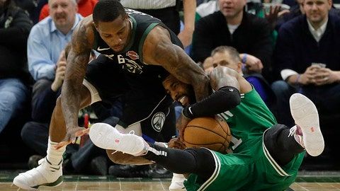 <p>               Boston Celtics' Kyrie Irving, right, and Milwaukee Bucks' Eric Bledsoe, left, fight for the ball during the second half of an NBA basketball game Thursday, Feb. 21, 2019, in Milwaukee. (AP Photo/Aaron Gash)             </p>