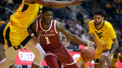 <p>               Oklahoma guard Rashard Odomes (1) drives while guarded by West Virginia forward Derek Culver (1) during the first half of an NCAA college basketball game Saturday, Feb. 2, 2019, in Morgantown, W.Va. (AP Photo/Raymond Thompson)             </p>